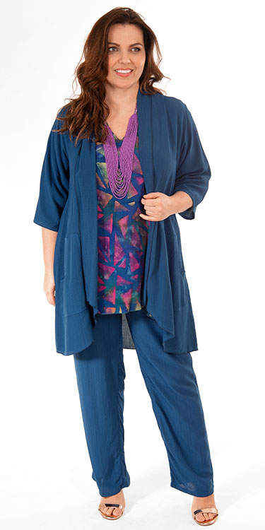 This model is wearing a batik print tunic with pocket from Angel Circle teamed with nocturnal (French navy) kimono and trousers in crinkle viscose. All by Danish designers Angel Circle available in plus sizes from Bakou in West Wimbledon.