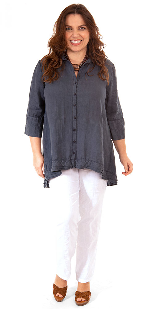 This image shows a model wearing a gorgeous linen shirt which is longer at the back from Grizas paired with K J Brand Wash & Go trousers in white. Available up to size 30 from Bakou in West Wimbledon.