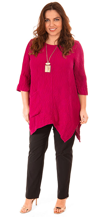This model is wearing a stunning silk and linen tunic from Grizas in Berry teamed with Mona Lisa lightweight narrow black trousers from Bakou in West Wimbledon.
