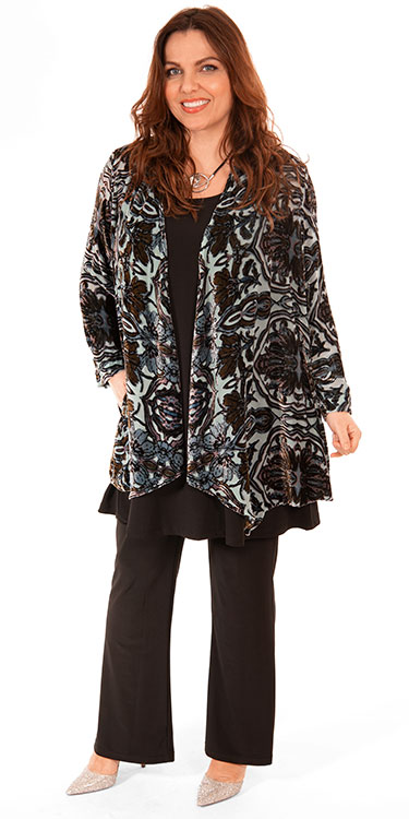 This model is wearing a stunning velvet print jacket paired with Yoek silky jersey vest and trousers available from Bakou in plus sizes.