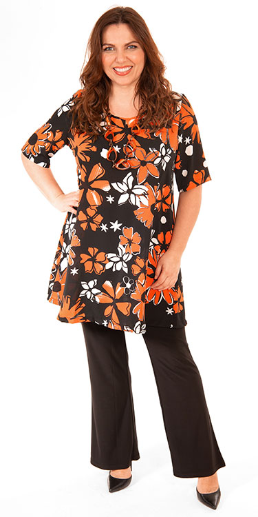 This model is wearing a fabulous orange/black retro floral print tunic from Yoek teamed with Yoek silky jersey bootleg trousers in black