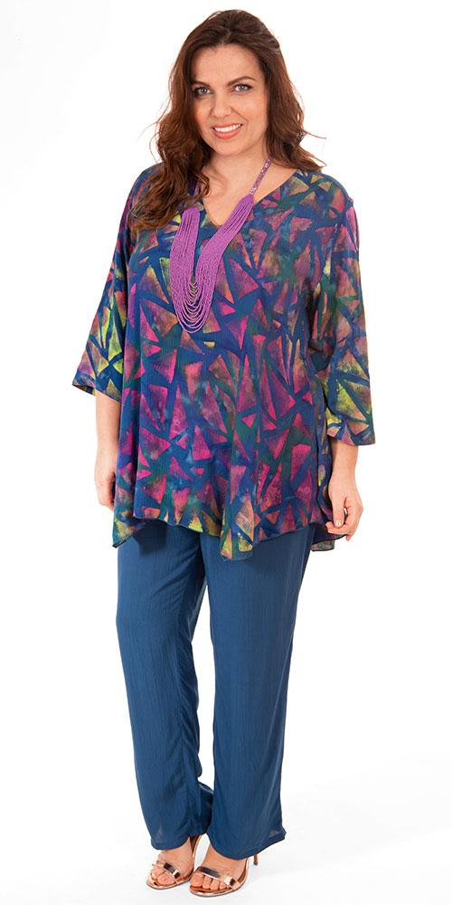 This image shows a model wearing a batik print v neck tunic with pocket and crinkle viscose trousers from Angel Circle.