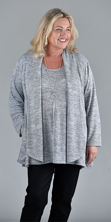 This model is wearing a silver grey marl waterfall Verona jacket from Kasbah Clothing and available in sizes 16-30 from Bakou. Teamed with matching Kristina sweater.