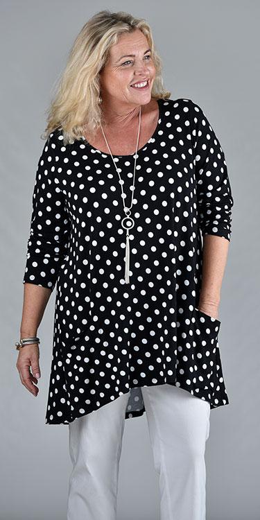 This model is wearing a black and white spotty Tiffin tunic with back pleat and pockets. From Kasbah Clothing and available from Bakou.