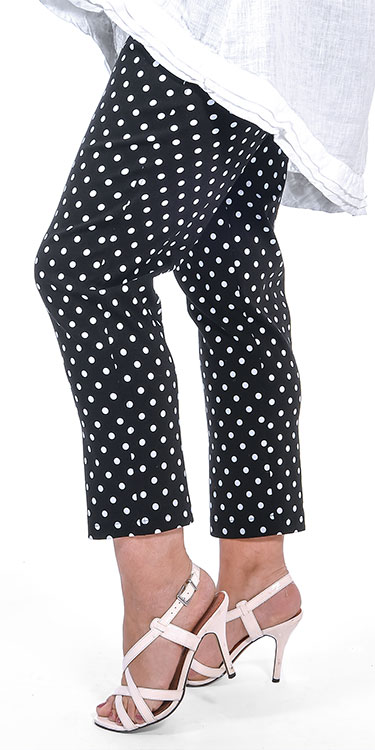 This model is wearing stretchy spotty black and white Bella crops from Robell