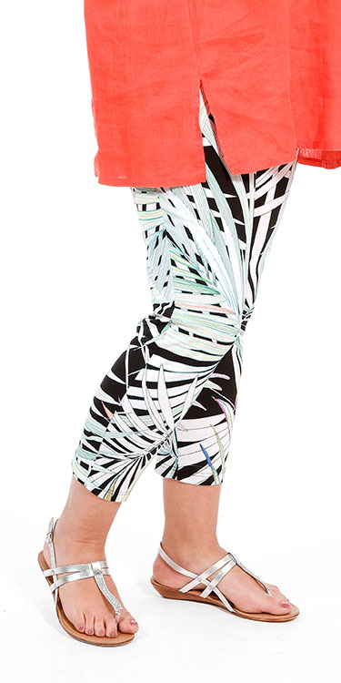 This model is wearing palm print cropped leggings from Doris Streich