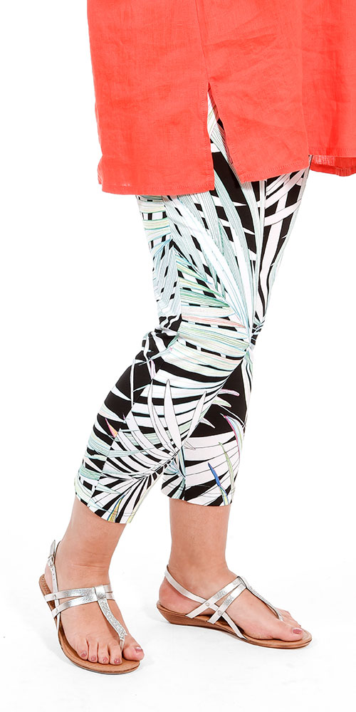This image shows a model wearing palm print cropped leggings from Doris Streich