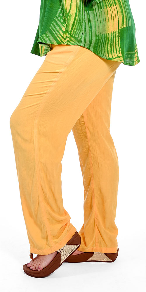 This image shows a model wearing crinkle viscose trousers from Angel Circle
