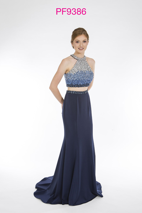 Prom girl wearing 2 piece gown in Navy with beaded bodice and fitted jersey skirt