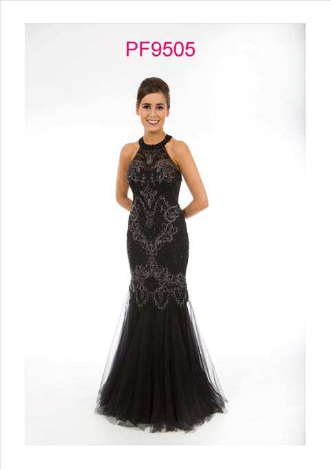 Prom girl wearing a black and silver fishtail gown with racer neck and key hole back detail