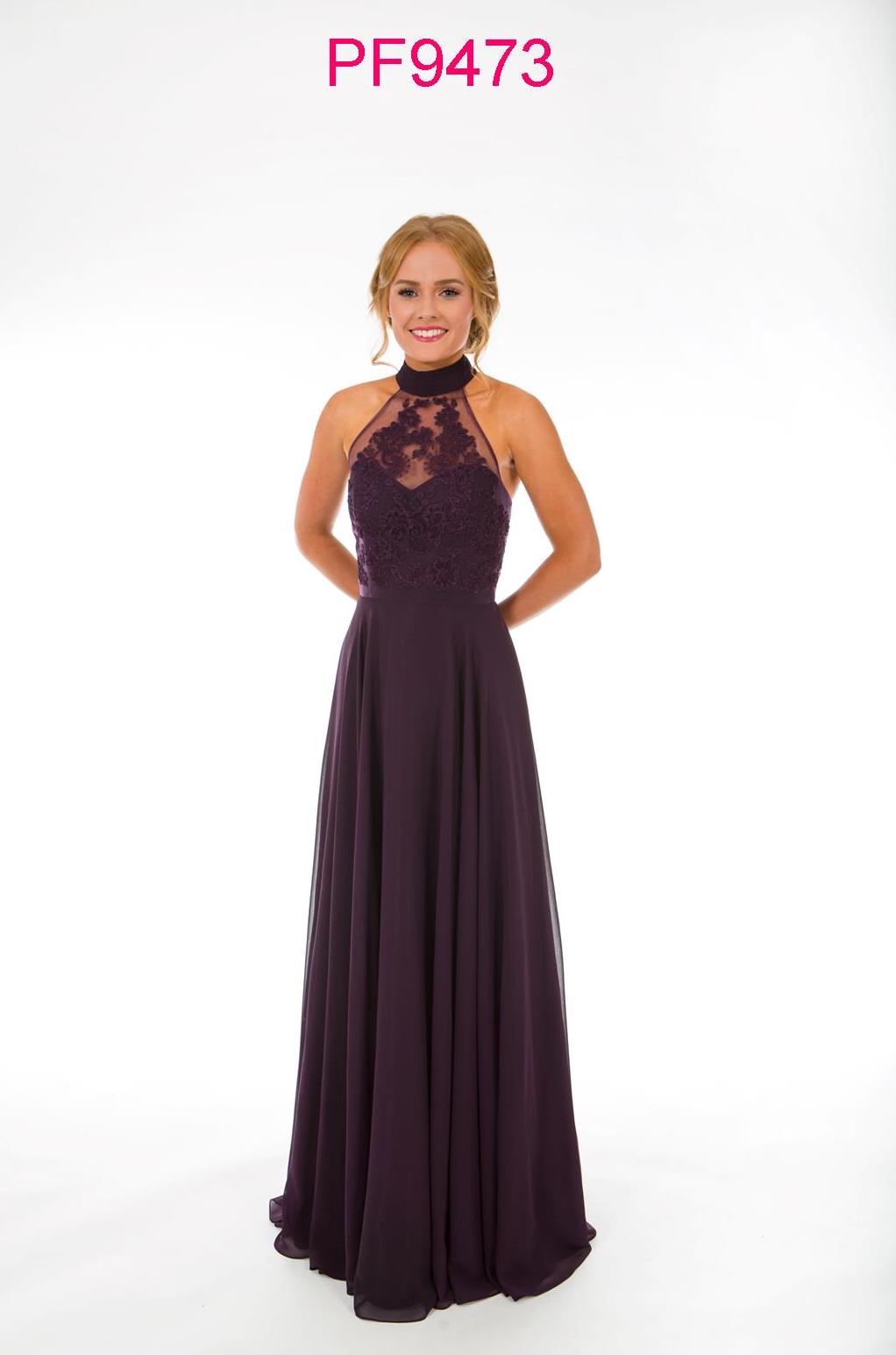 Prom girl wearing damson coloured gown with racer neck, lace bodice and full chiffon skirt.