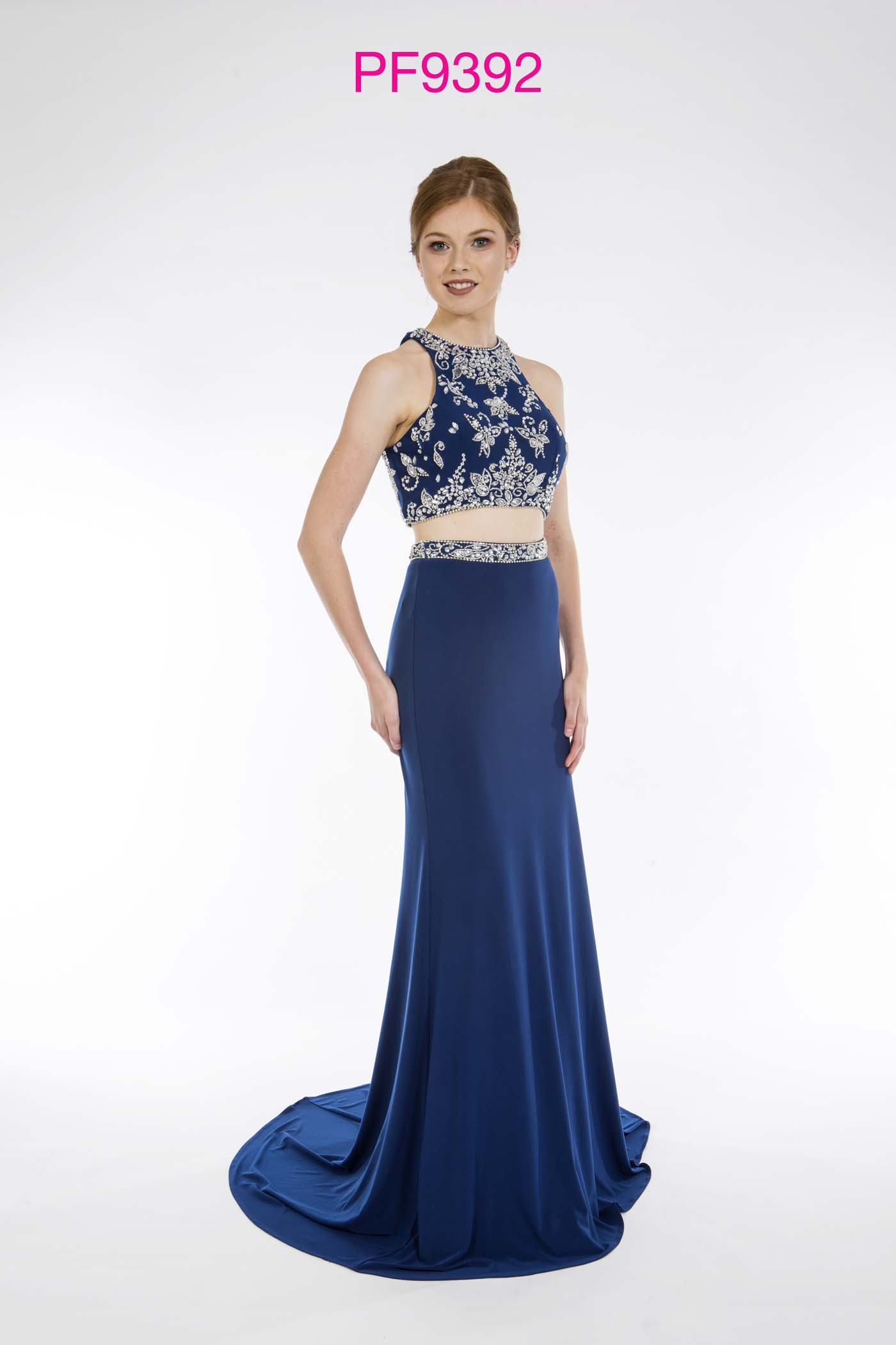 Prom girl wearing navy jersey 2 piece gown with silver beaded top and figure hugging skirt with train