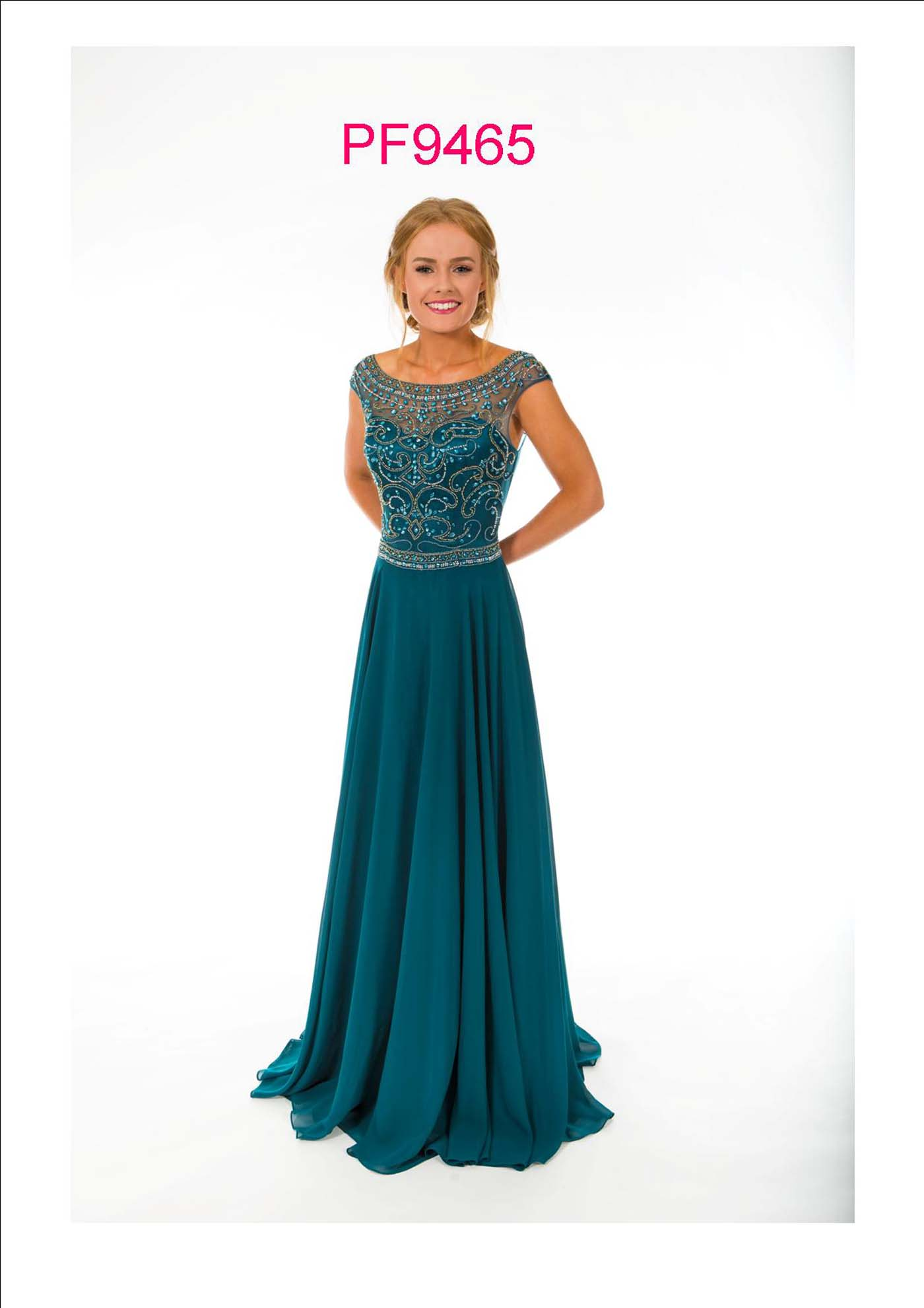Prom girl wearing chiffon gown with full skirt and silver beaded bodice, high front neck and low v back.