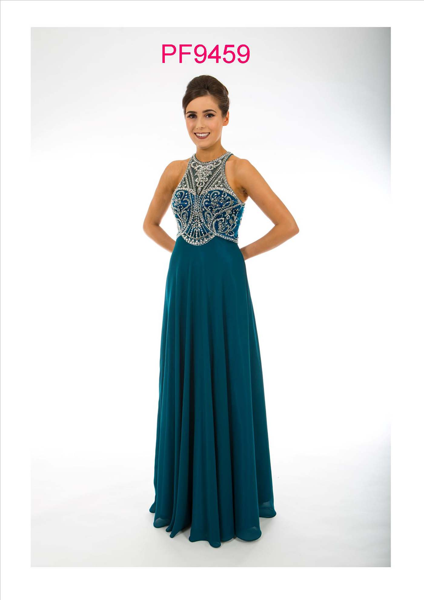 Prom girl wearing green chiffon gown with full skirt and silver beaded bodice