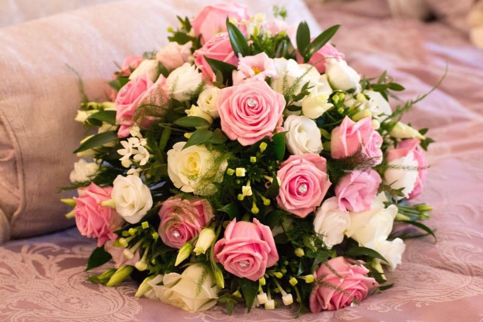 A hand tied posy with pink and white roses
