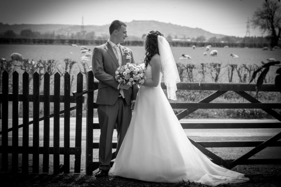 A bride and groom taking a moment to themselves looking over open fields
