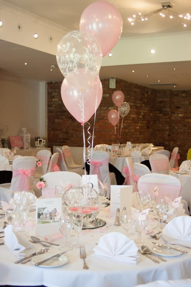 Wedding breakfast set and ready in a pink and grey colour theme.