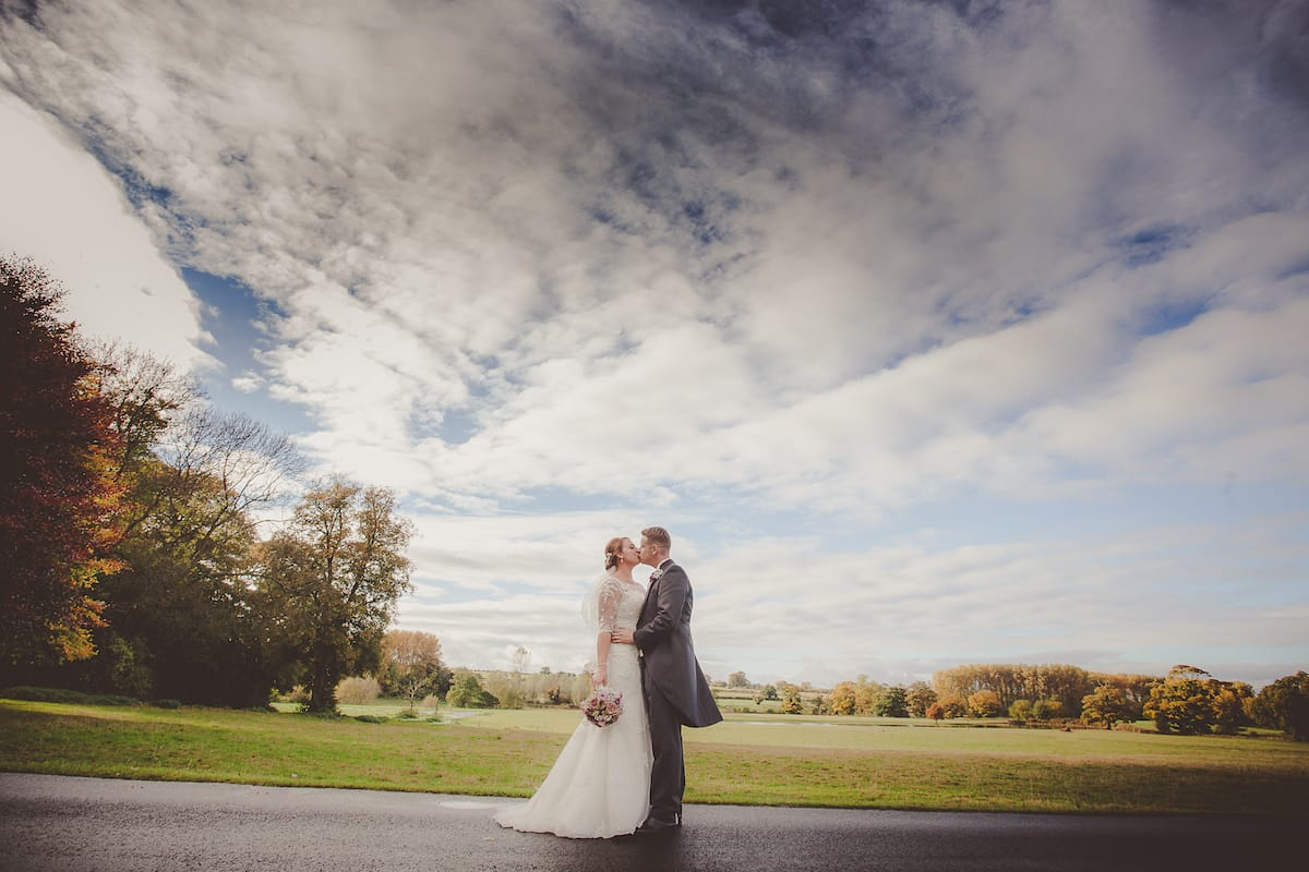 Bride and Groom embraced in the grounds of there reception