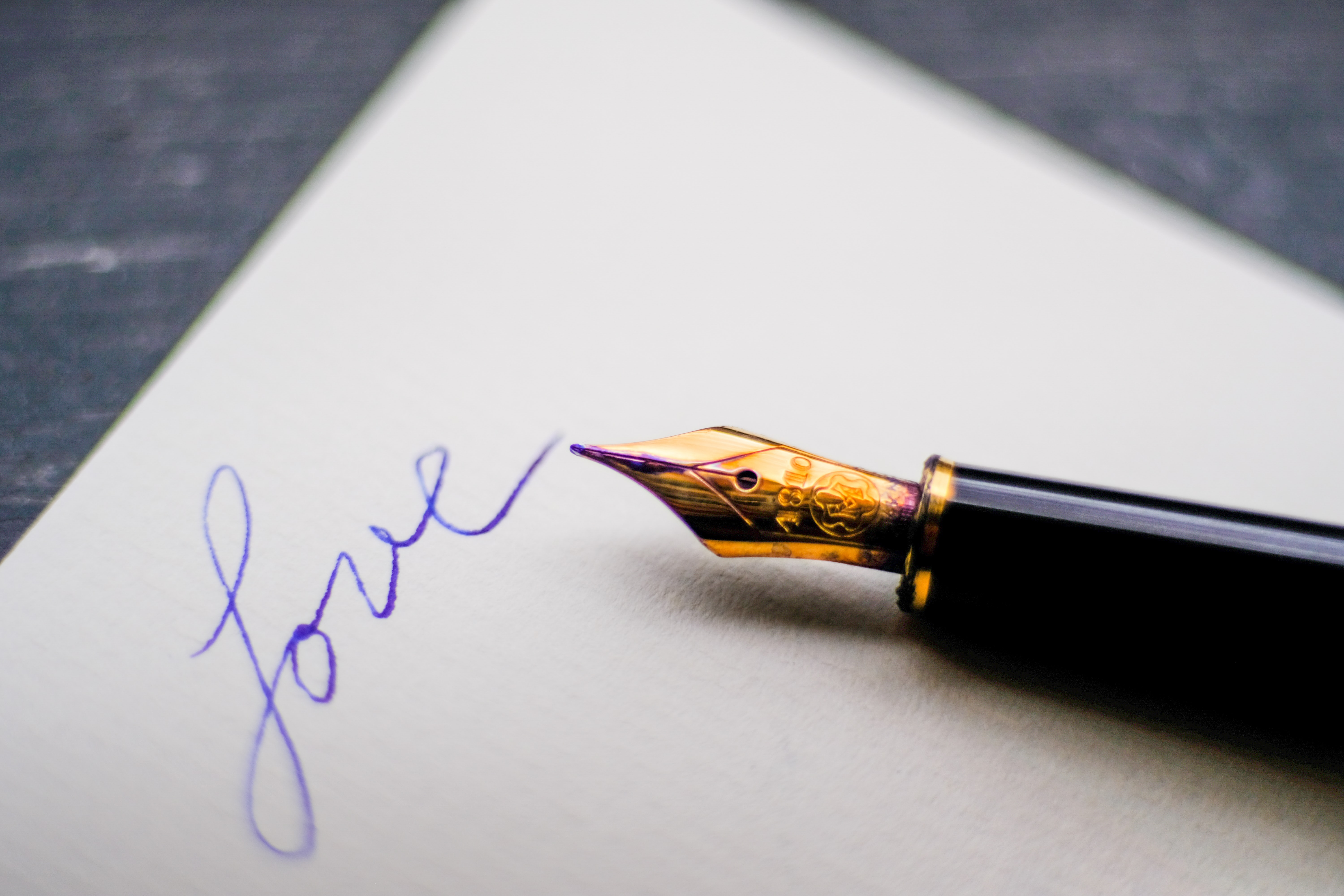 a fountain pen and paper ready to write a love letter.