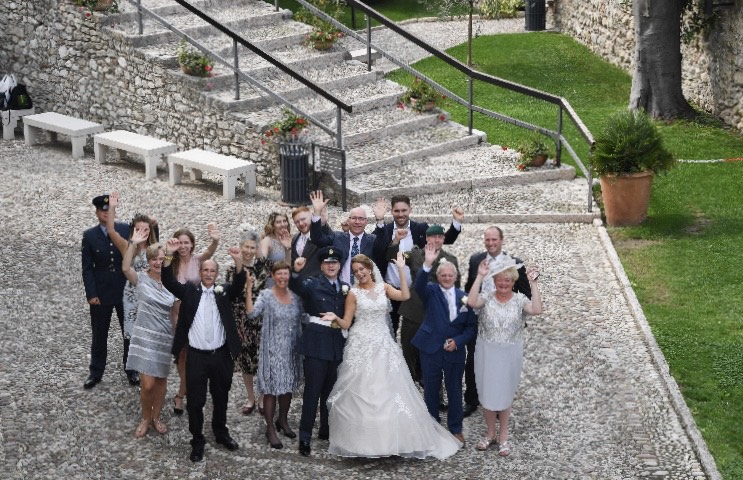 A bridal party in the grounds of