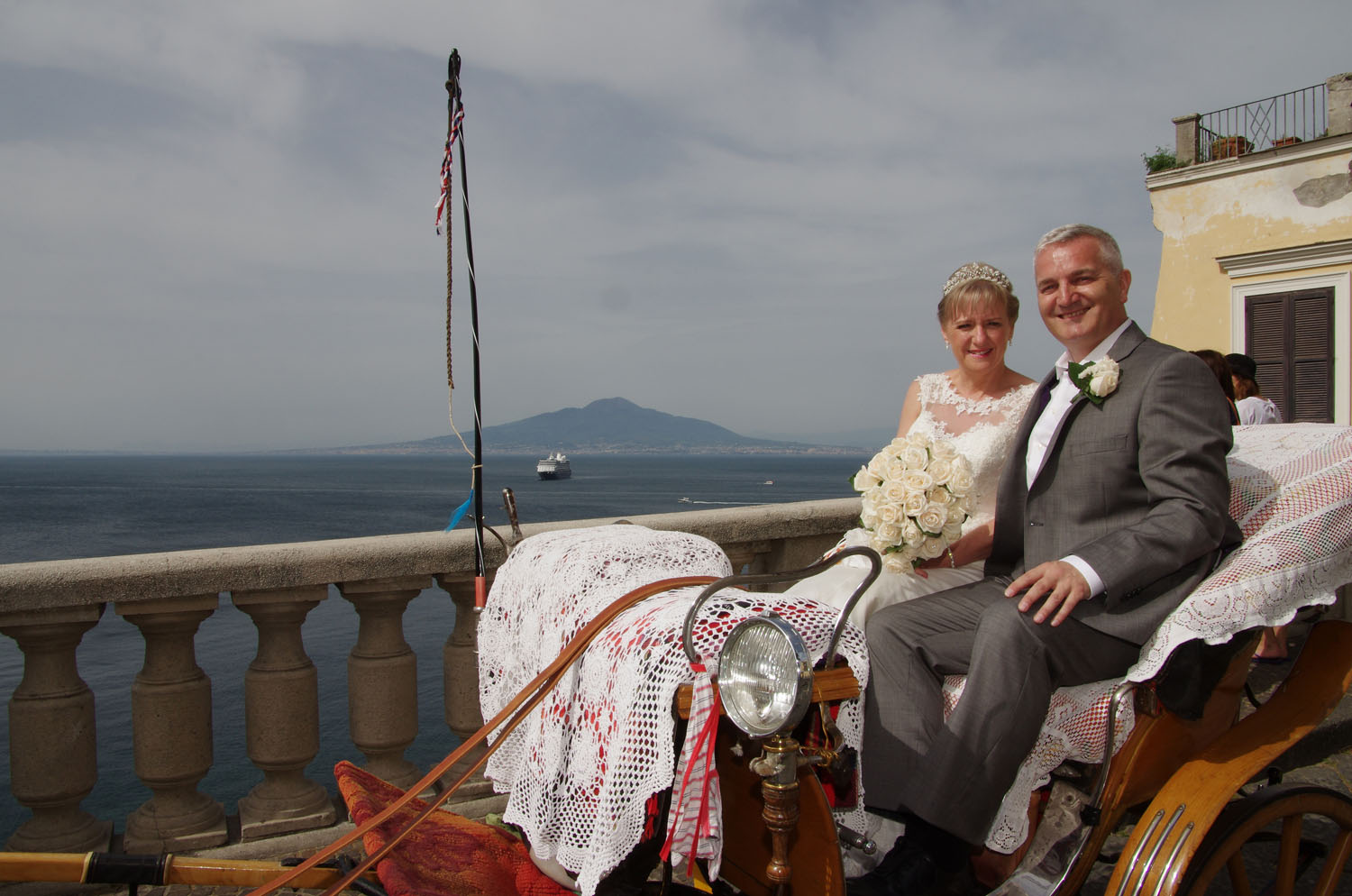 Bride and Groom in a horse drawn carriage on the way to their wedding.