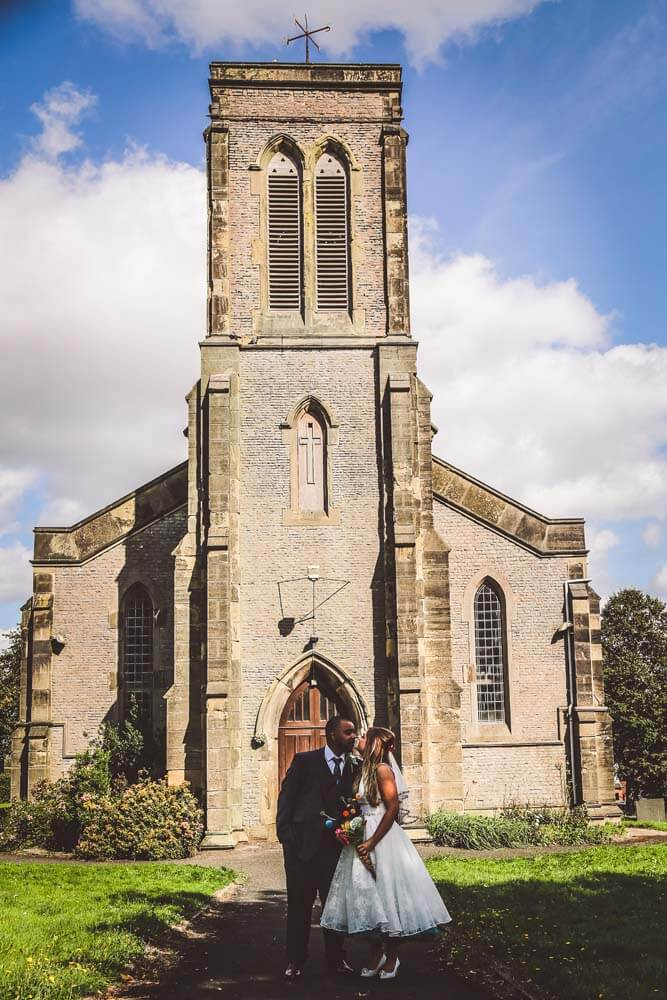 Bride and Groom in front of the church.