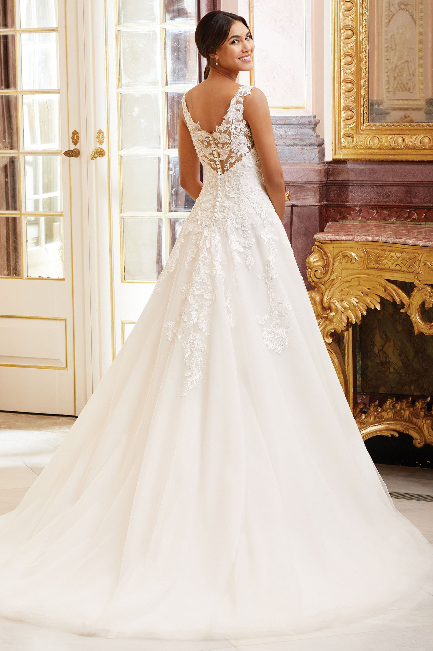 Bride wearing a princess style own with high llusion back.
