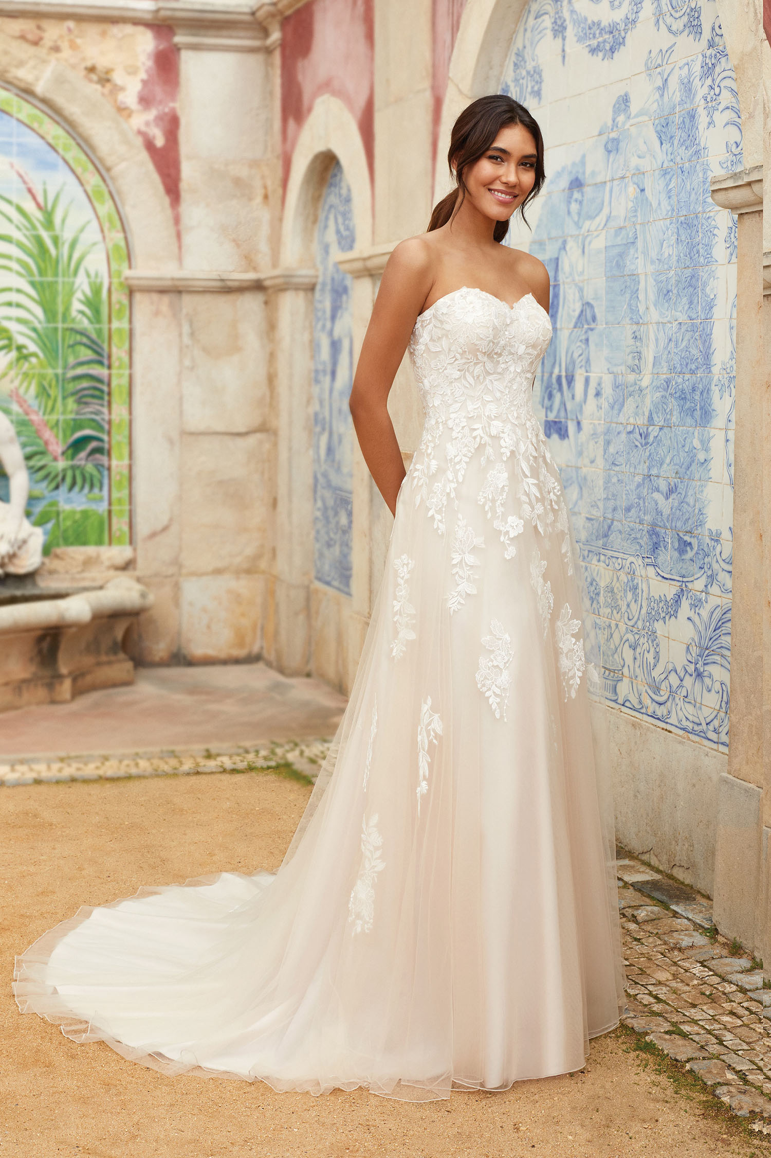 Bride wearing simle fit and flare gown with beaded motifs