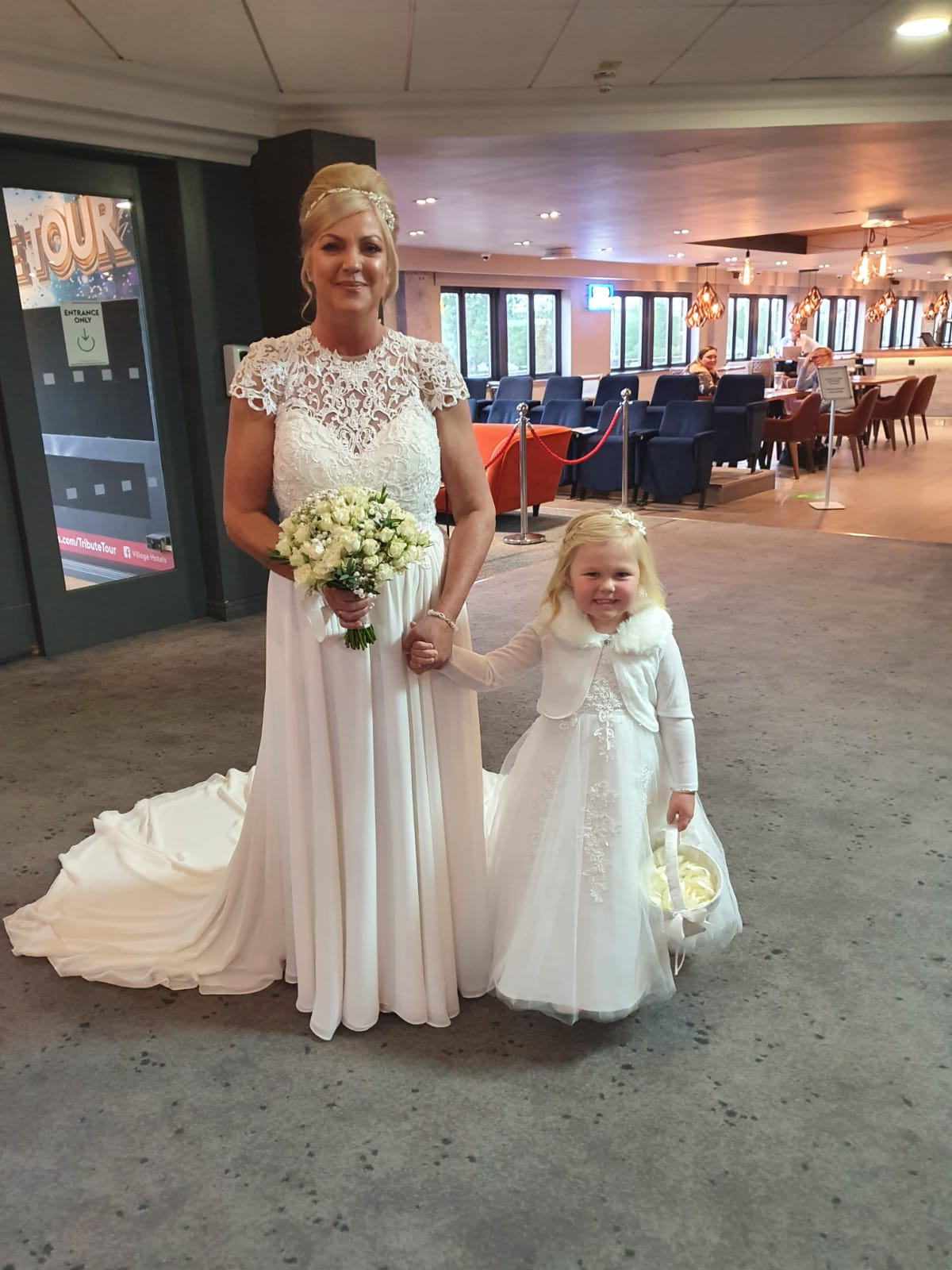 Bride and her flower girl in ivory matching dresses