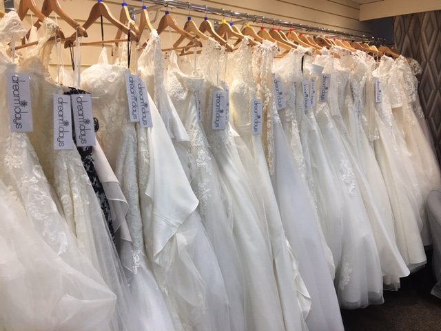Rail of wedding dresses in a bridal store