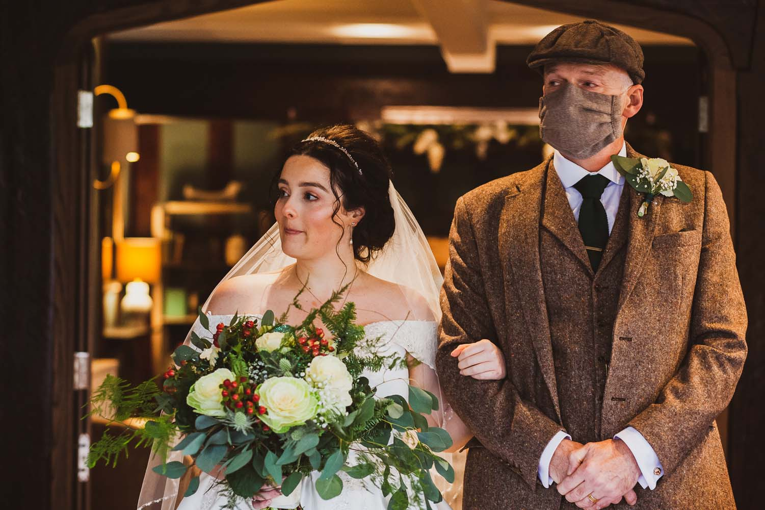 Bride walking down the aisle with her dad at her Peaky Blinder themed  wedding