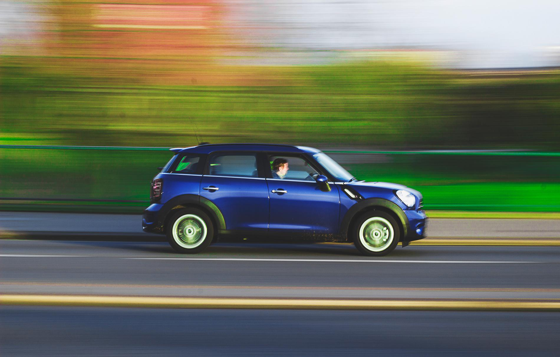 Mini Cooper driving down road