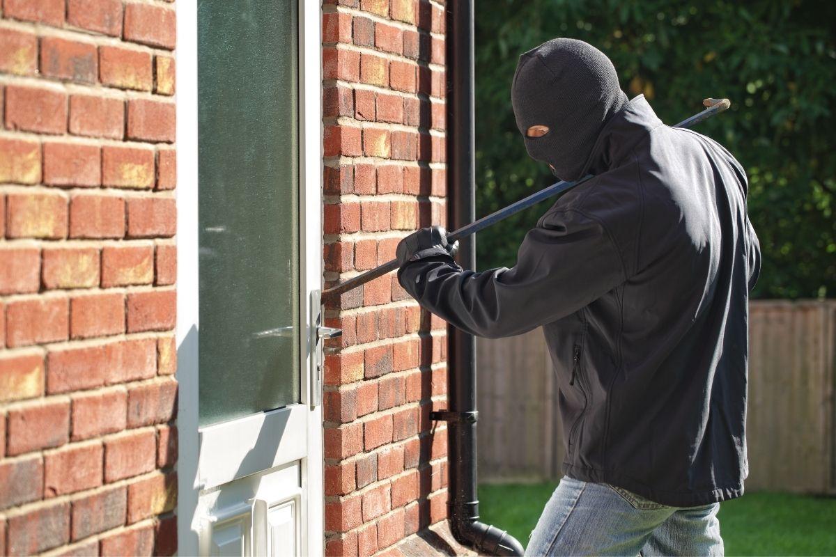 Burglar breaking into home