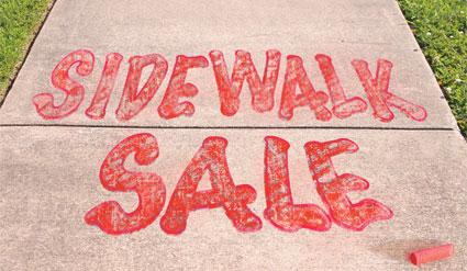 Sidewalk sale written on a sidewalk