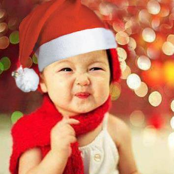Young child wearing a Santa hat