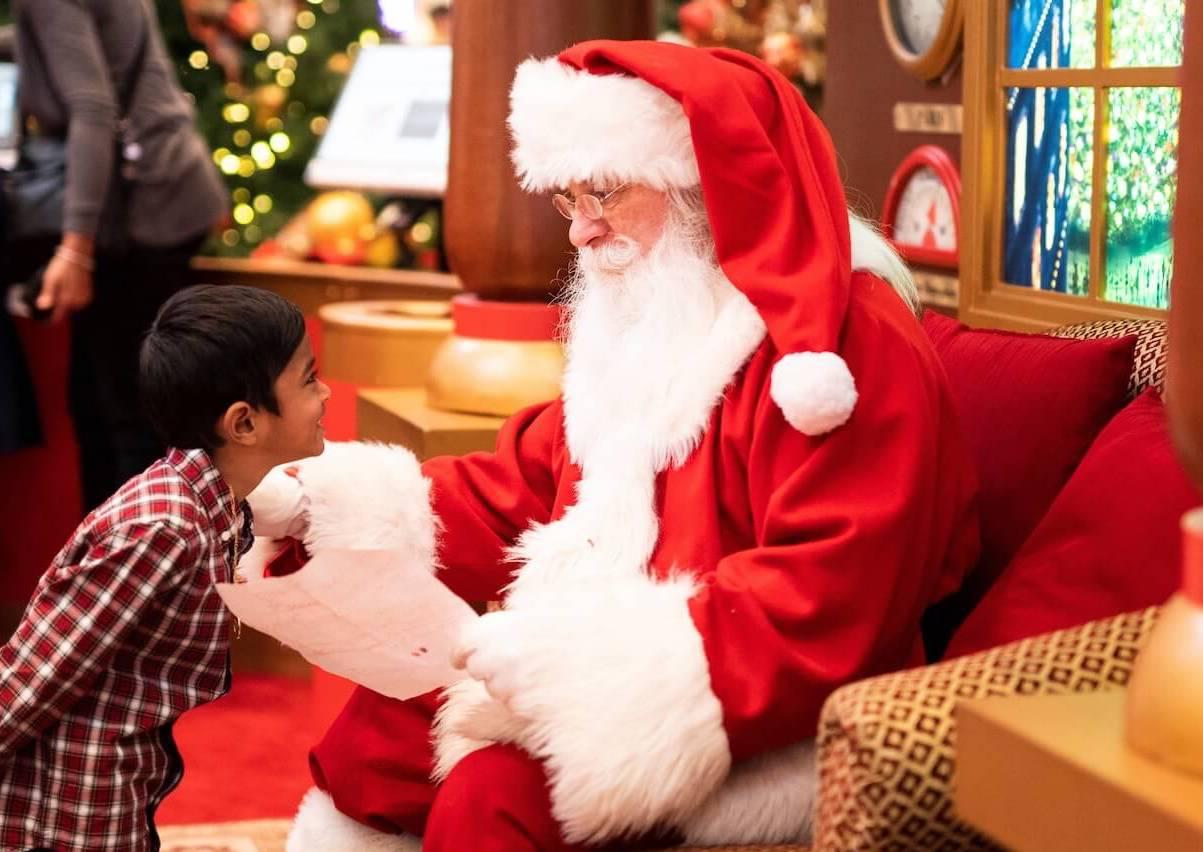 Photo of a boy talking to Santa
