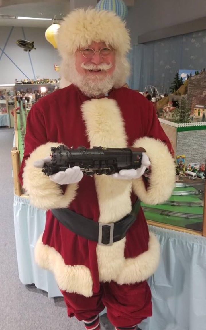 Santa holding a train