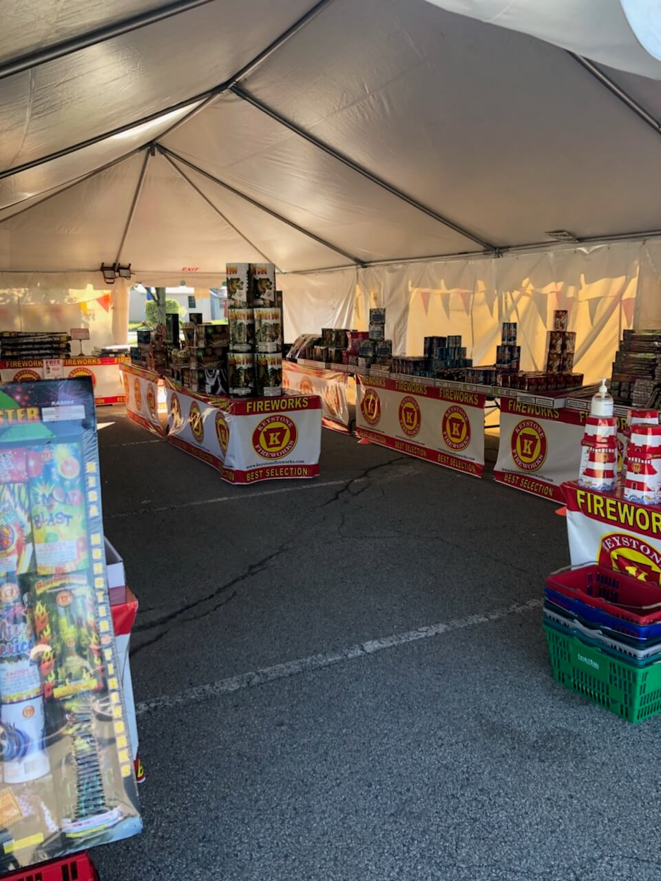 Photo of inside a fireworks tent with fireworks selections on tables