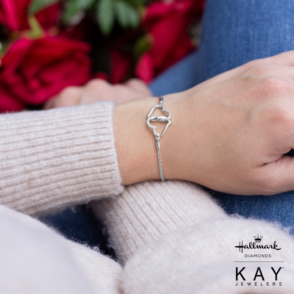 Model wearing Kay jewelers silver heart bracelet