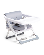 a white and gray tabletop high chair