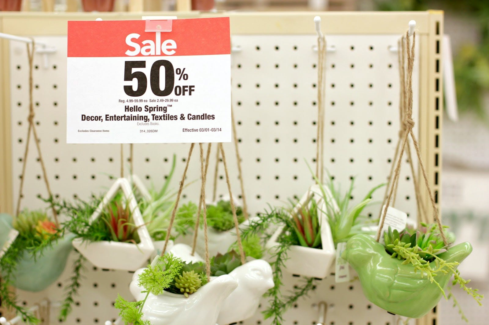 50% off sign in front of spring planters at Joann's Fabric