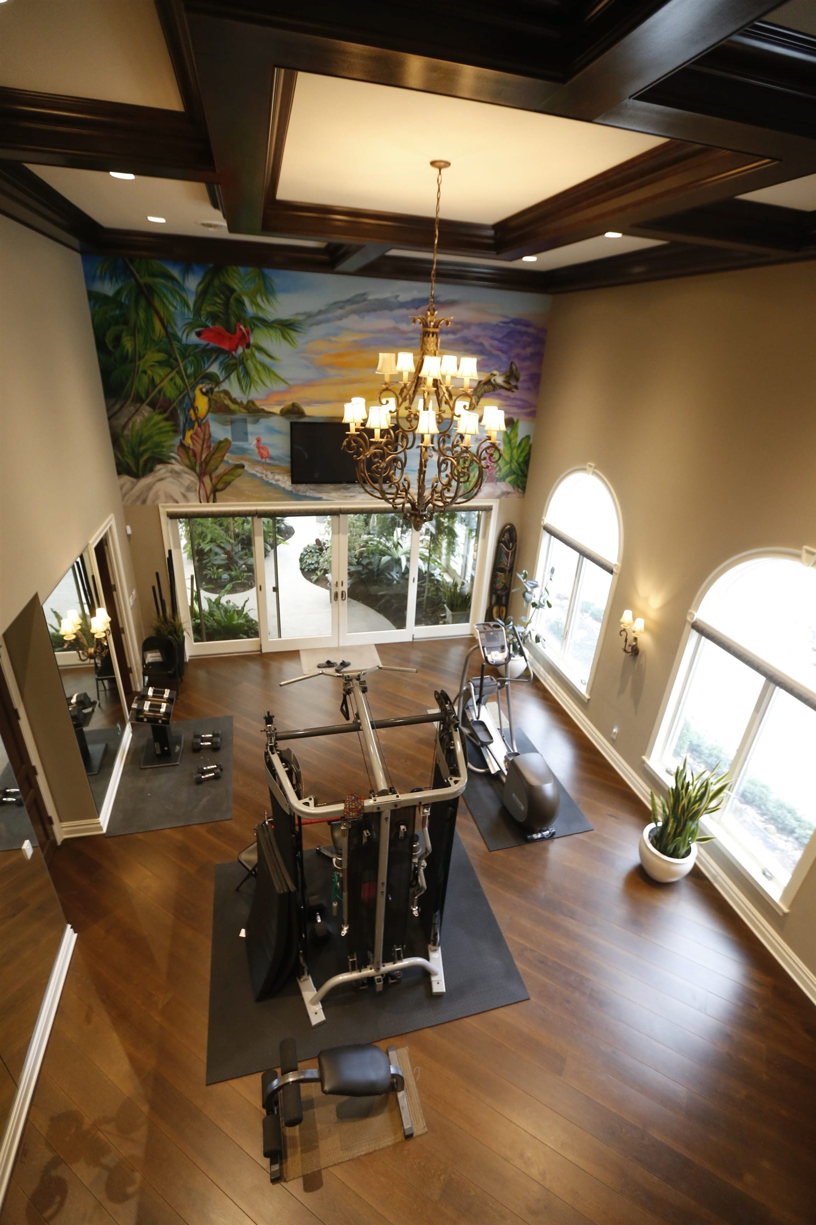gym room with chandelier