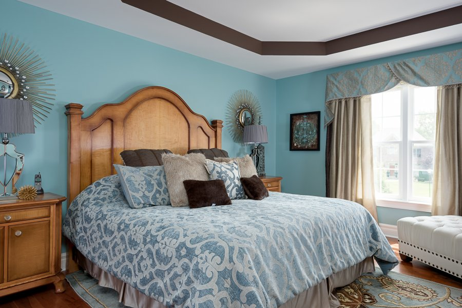 tray ceiling in a blue bedroom