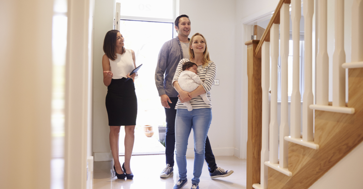 new family looking at new home with baby