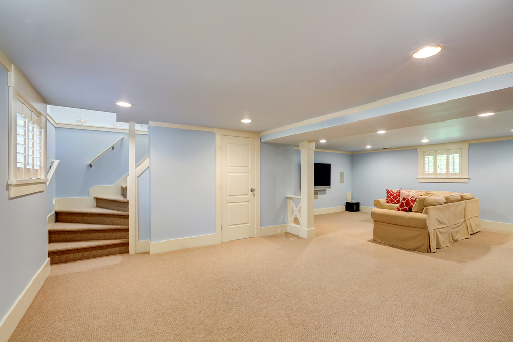 clean basement with blue walls and open floor
