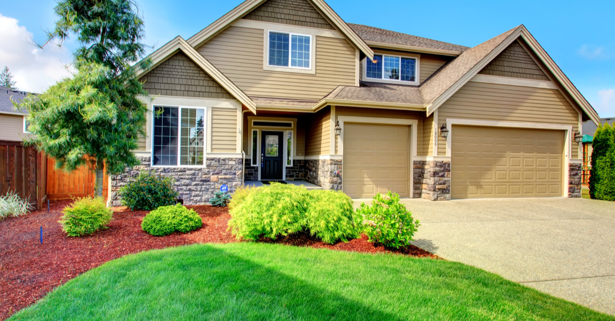 brown home exterior with landscaping