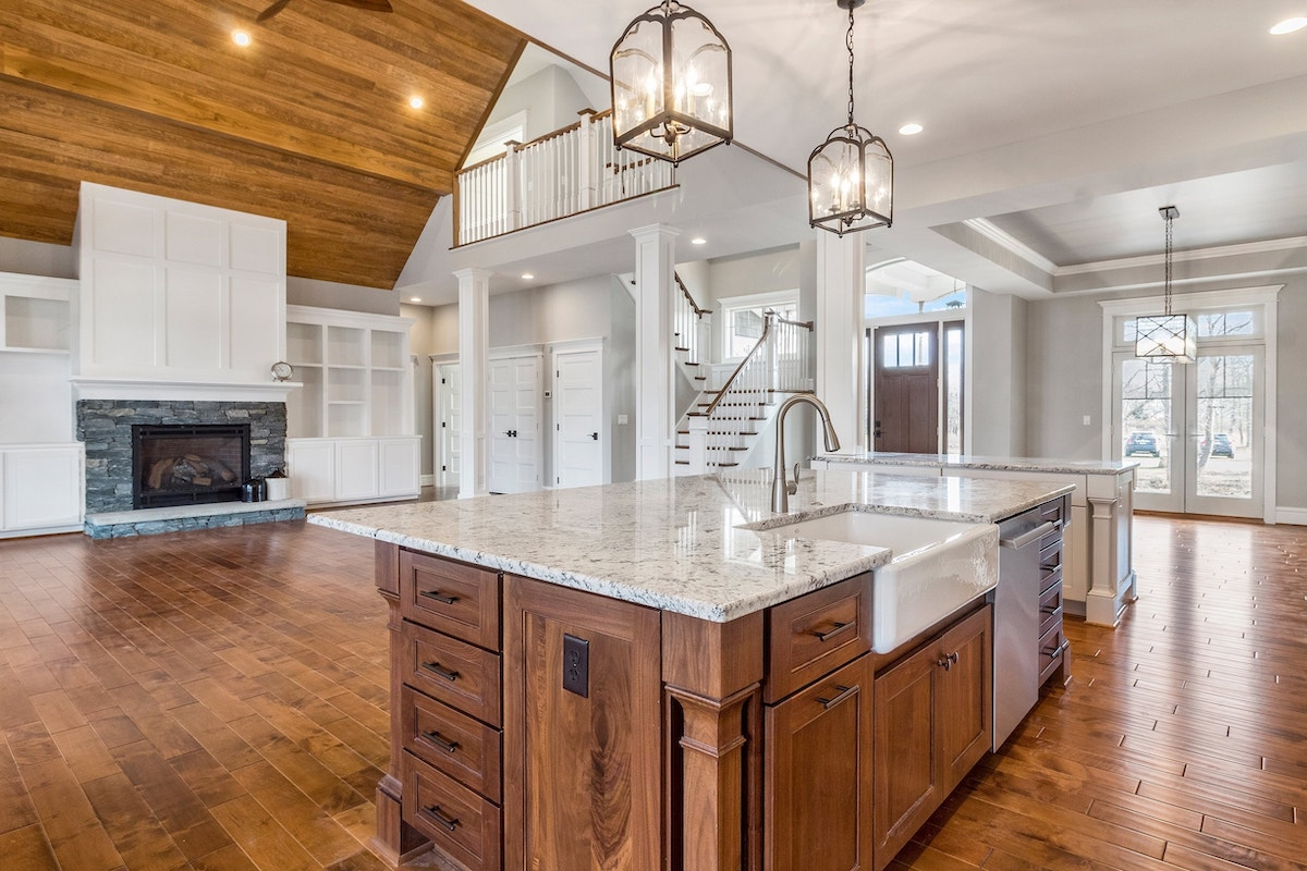 large open floor plan with fireplace aiming towards kitchen
