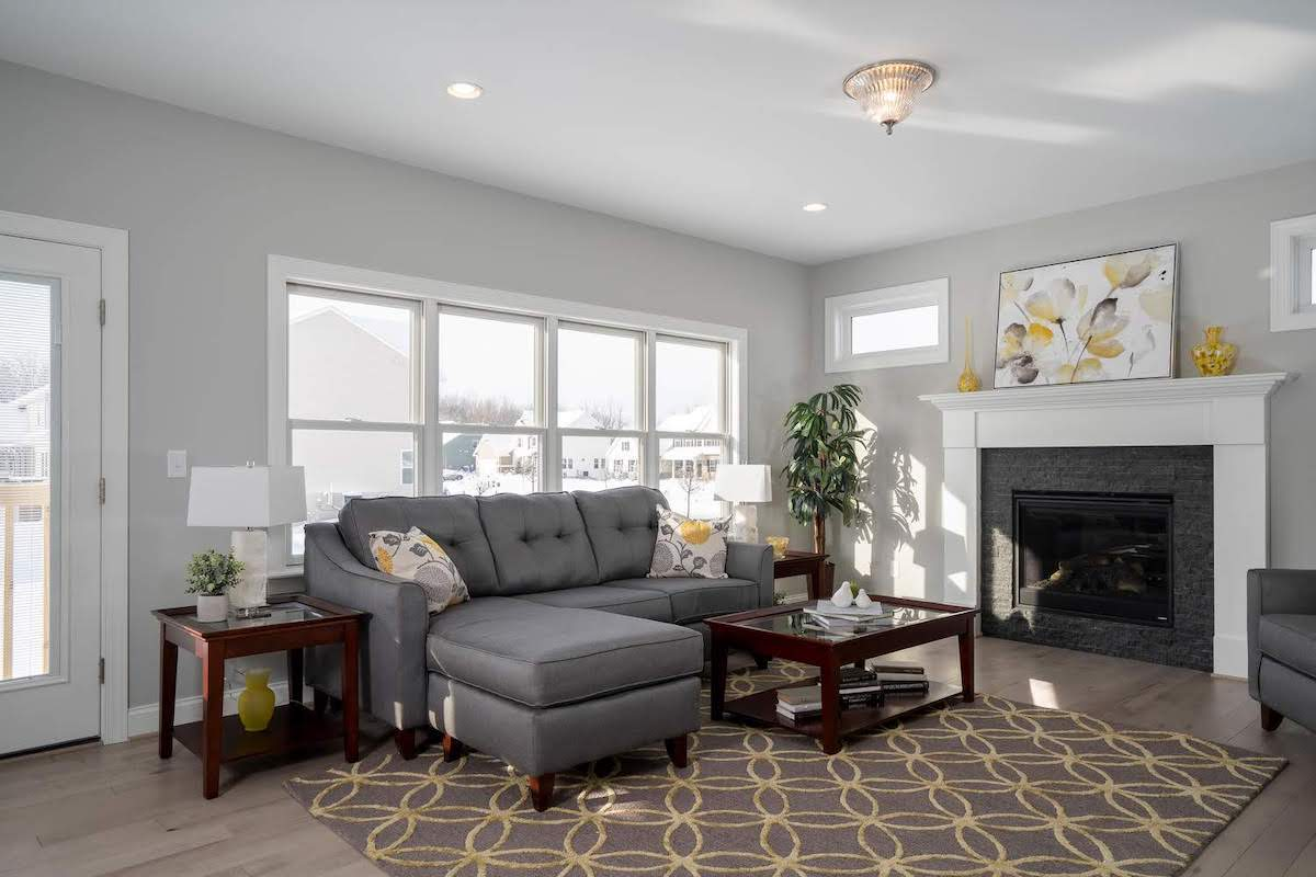 fireplace in medium sized room with grey and yellow color