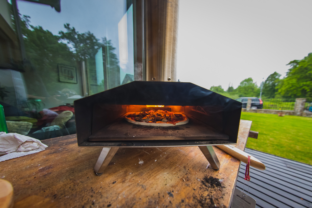 Interior view of a pellet fired home pizza oven in a garden