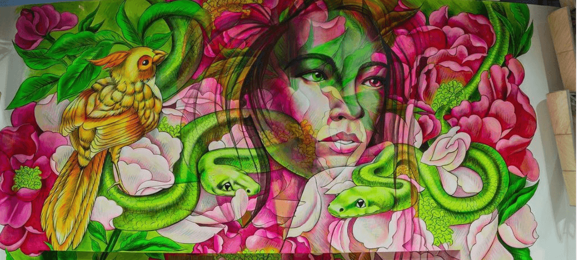 Mural of a woman surrounded by flowers, a bird, and snakes by Artist Amandalynn
